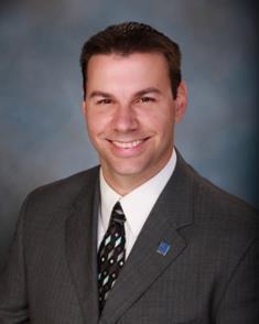 Mark E. Mohn