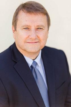 Greg M. Andrews